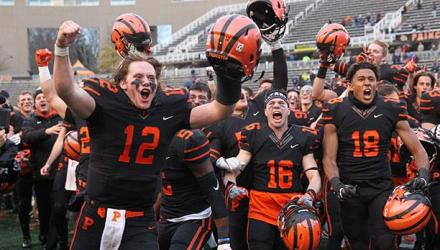 Princeton football players celebrating after win