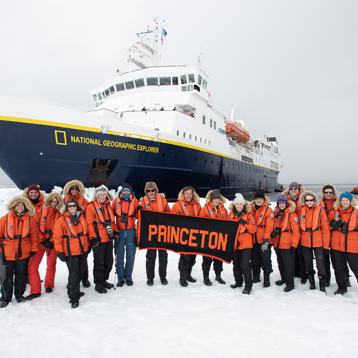 Group of travelers near cruise ship in Antarctica