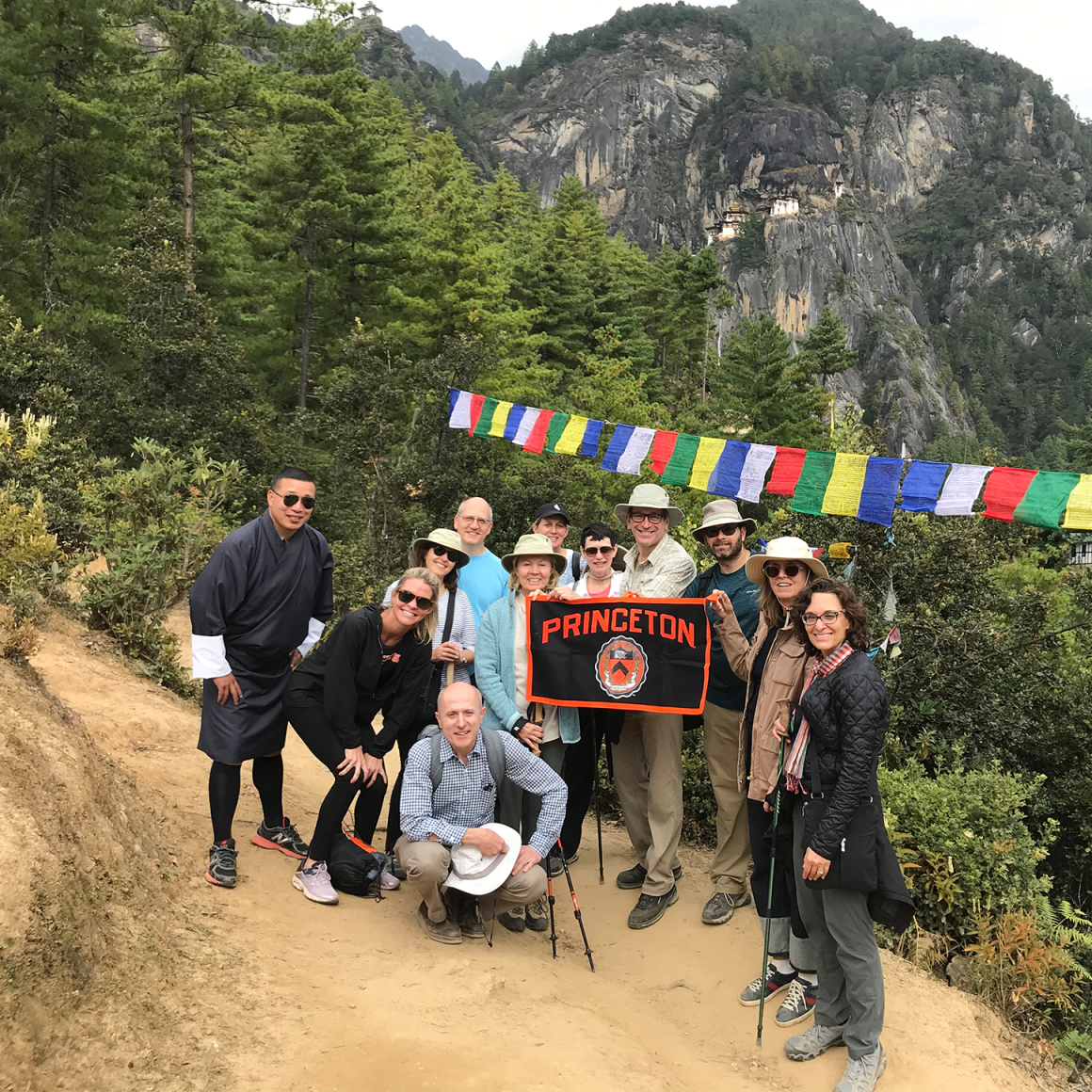 Group of travelers on side of mountain in Bhutan