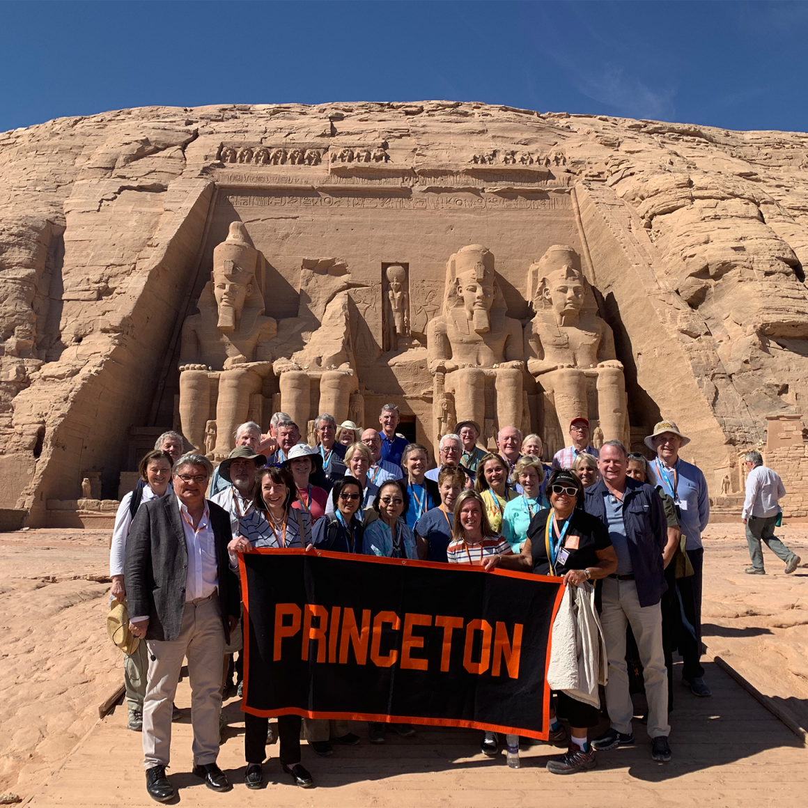 Travelers with Princeton banner in the Egyptian desert.