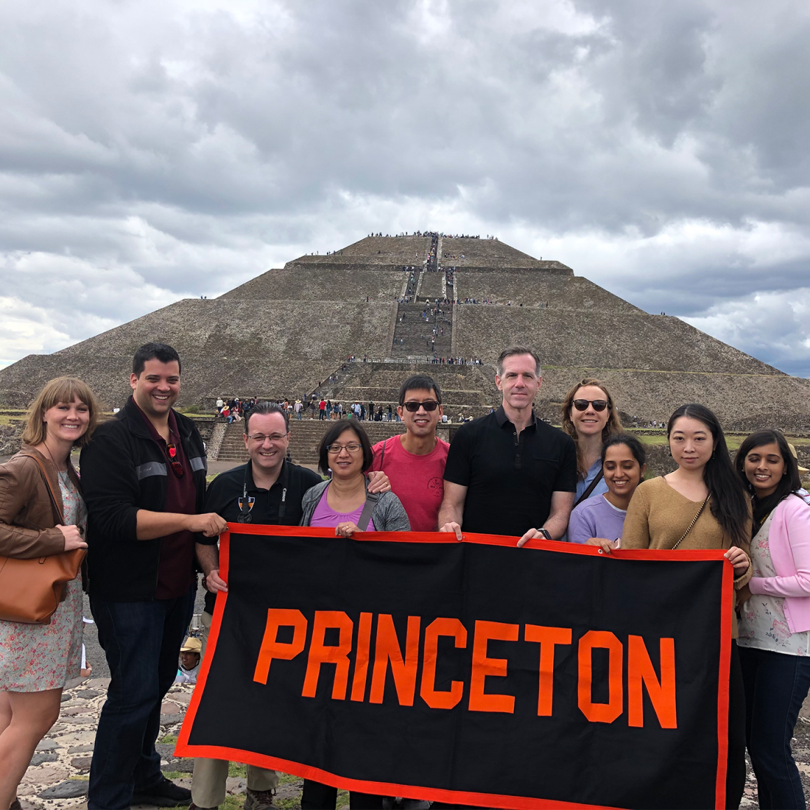 Princeton Journeys travelers holding Princeton banner in Mexico