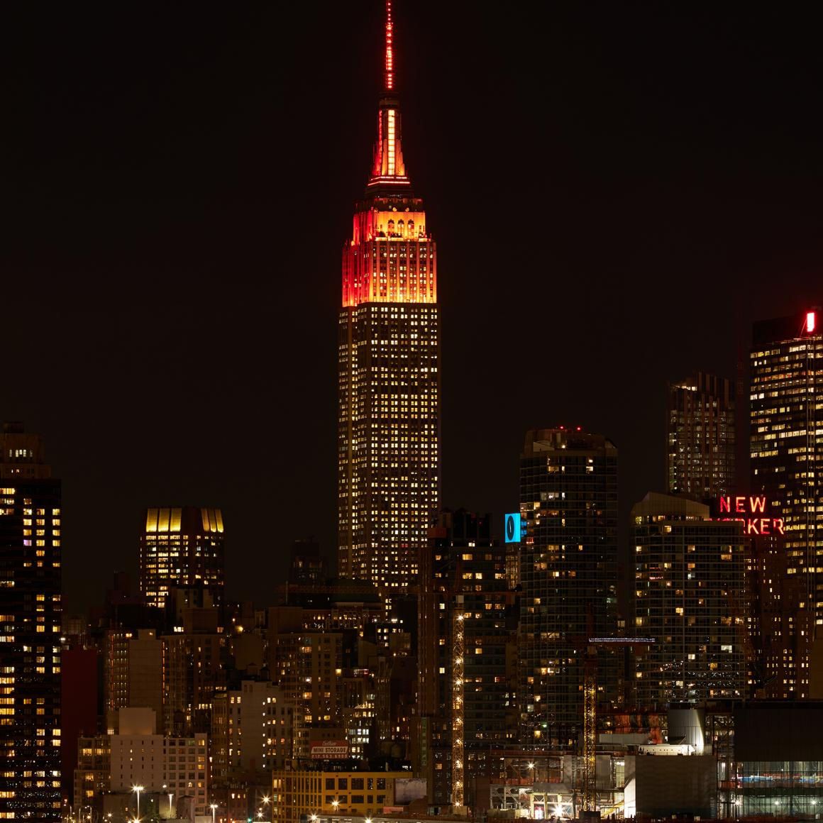 Empire State Building lighted orange at the top