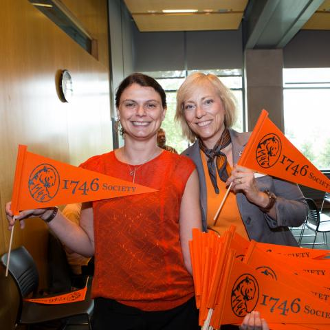 Gift Planning staff members holding 1746 Society flags